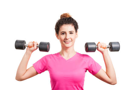 Fit young woman training her deltoids with barbells isolated on white Stock Photo