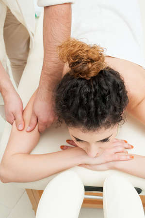 pamper: Young woman getting a spa massage of shoulder and pamper in spa center Stock Photo