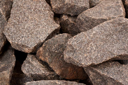 hot rock therapy: Close-up of natural gray rough stone used in sauna for decoration and making steam