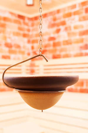 vapour: Close-up of hanging bowl in salty sauna for making  aromatic vapour Stock Photo