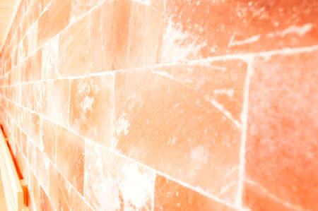 himalayan salt: Closeup of himalayan salt wall in sauna room as  textured concept