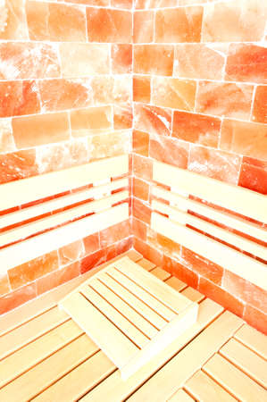 head support: Closeup of head support, wooden bench and salty wall as healthy concept in sauna