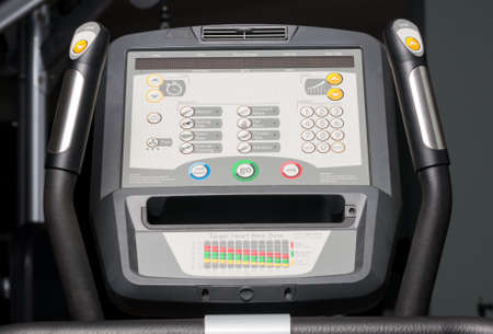 cardio workout: Close-up of bycicle monitor with buttons, handles and levels settings for cardio workout in a gym Stock Photo