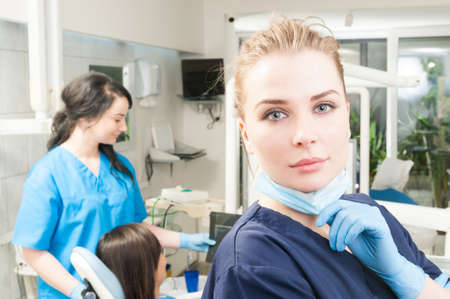 x ray equipment: Close-up portrait of young orthodontist in dental clinic wearing uniform and gloves Stock Photo