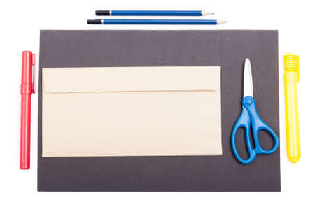 envelop: Top view of office supplies and envelop on black paper with copypaste