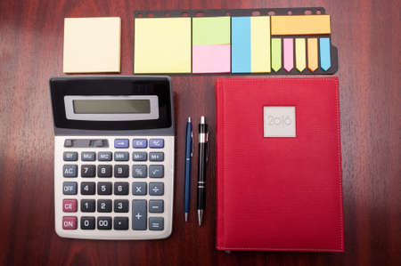 organized office: View from above of wooden organized office desk as planning and business accounting concept Stock Photo