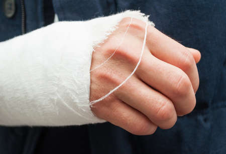 white bandage: Closeup hand and fingers with white bandage as trauma or accident concept