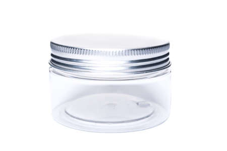 Small new plastic jar or recipient with aluminum lid cap isolated on white copy space background