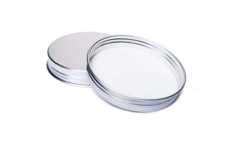 lids: New aluminum caps or lids for jars isolated on white background