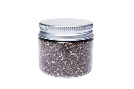 recipient: Transparent plastic jar with chia seed as natural organic food concept isolated on white background