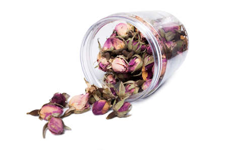 recipient: Dry flower blooms for tea in plastic jar or recipient isolated presentation on white background Stock Photo
