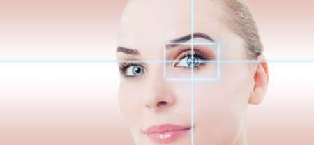 futuristic eye: Woman futuristic eye with laser high-tech identification as medicine and vision concept against pink or purple background