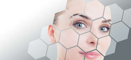 facial care: Close-up of woman perfect face with beauty correction and makeup against gray background gradient