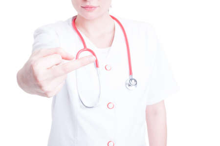 uneducated: Young woman doctor making a rude gesture as bad behavior or attitude concept on white studio background