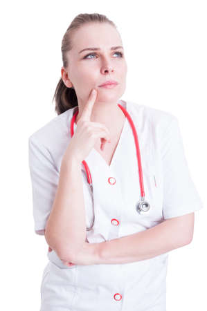 thoughful: Portrait of pensive woman doctor looking up contemplative and thoughful isolated on white background