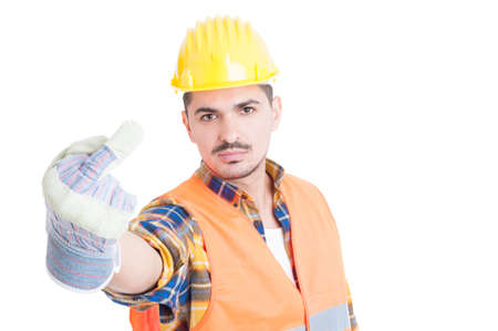 arrogant: Young constructor showing obscene middle finger gesture acting rude and arrogant isolated on white background with copy paste Stock Photo
