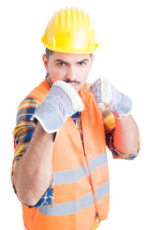 bad attitude: Furious engineer showing his fists and standing in fighting position with bad attitude on his face isolated on white