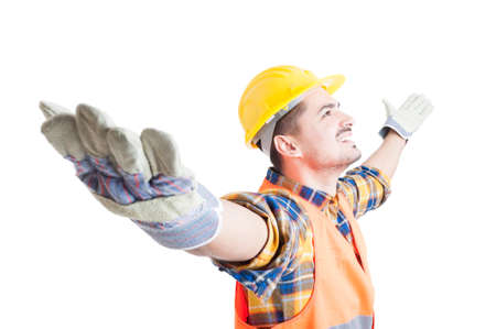 arms wide open: Portrait of happy constructor with arms wide open celebrating success, looking up and smile on white background