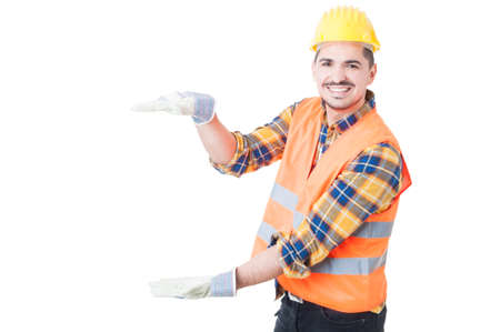 unifrom: Attractive engineer holding something big while acting cheerful with copy space isolated on white background