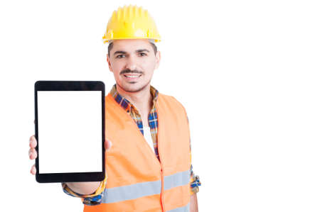 blank tablet: Cheerful engineer holding a digital tablet with blank screen and advertising area isolated on white