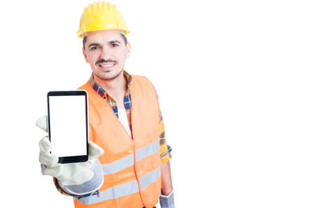 Happy builder showing a blank smart phone screen with copyspace isolated on white background
