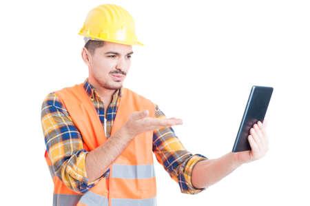 thru: Handsome engineer sending kisses online thru modern tablet as flirt and affection concept isolated on white