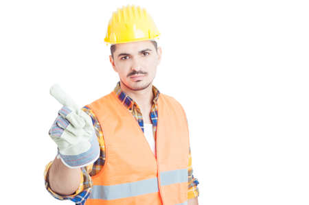 denial: Serious engineer wearing gloves and doing no or denial gesture with his finger isolated on white Stock Photo
