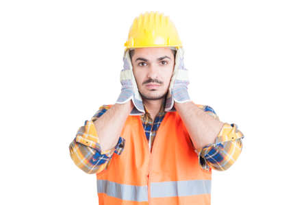 denial: Hear no evil gesture with handsome engineer or constructor as deaf or denial concept isolated on white background