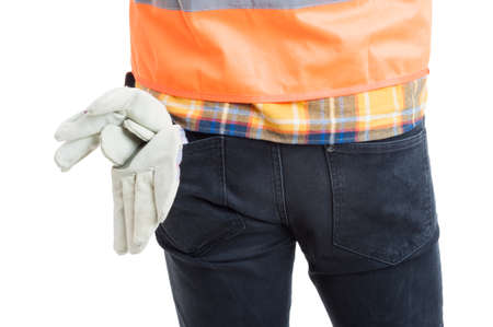 back posing: Closeup of young constructor back posing in uniform or equipment as safe workwear concept isolated on white
