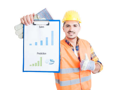 stock predictions: Young constructor thumb up and hold sales chart on clipboard as profit report concept isolated on white background