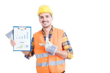 sales chart: Happy builder pointing finger and holding  clipboard sales chart in his hands on white background