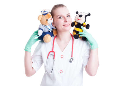 pediatrist: Trusthworthy female doctor concept with young doctor holding plush animals and acting funny on white background