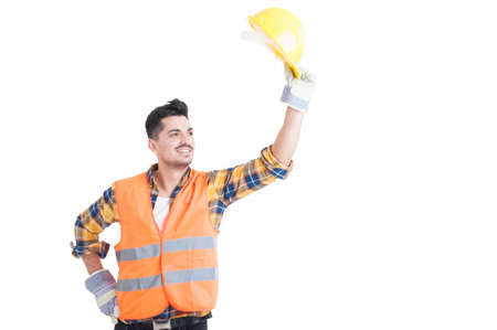 salutation: Portrait of handsome constructor or engineer raise his protection helmet up as greeting or salutation concept isolated on white background Stock Photo