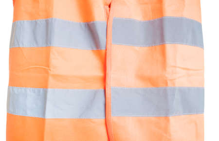 reflective: Close-up of orange reflective vest as part of protection uniform isolated on white background