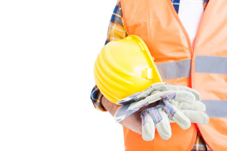 reflective vest: Concept of secure equipment with helmet, reflective vest and gloves in close-up isolated on white