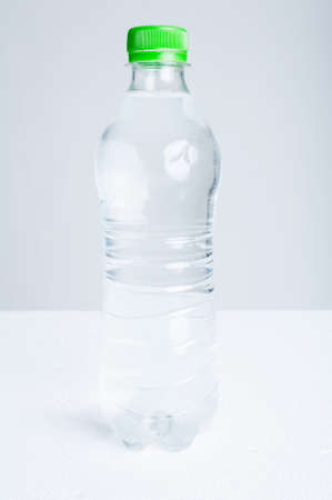 purified: Plastic bottle of purified drinking water as hydration and refreshment concept isolated on white background Stock Photo