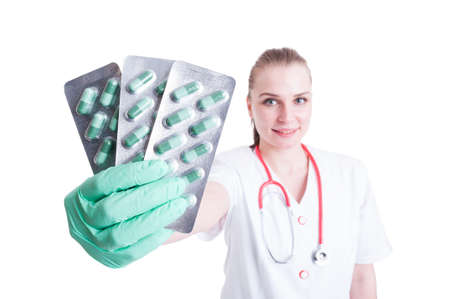 blister package: Close-up of pills in blister package in woman doctor hand as pharmaceutical concept isolated on white