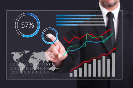 business performance: Digital business performance graphs with businessman touching transparent screen as global economy concept Stock Photo
