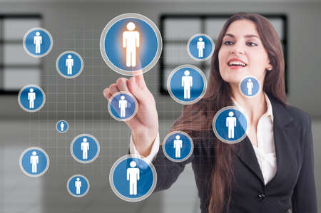 our company: About our company or management leadership concept with business woman pressing futuristic button on transparent display Stock Photo