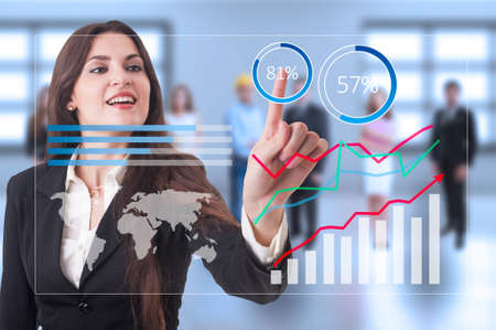 activating: Futuristic financial growth graphs on transparent screen and business woman activating profit button Stock Photo