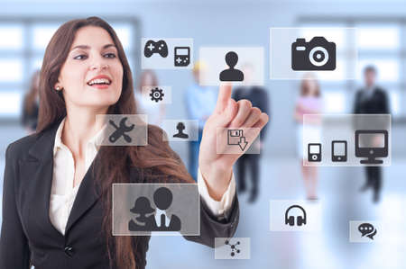 futuristic woman: Futuristic multimedia connections as cloud computing concept with modern business woman pressing button