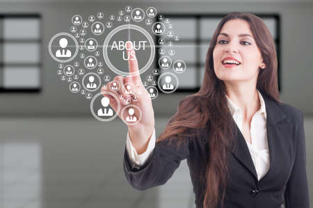Futuristic about us concept on hi-tech touchscreen and business woman pressing button