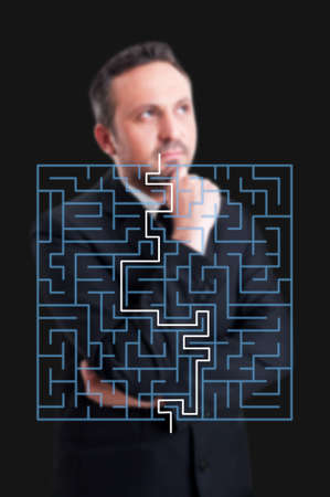 fastest: Successful business manager thinking to find fastest path in maze or the perfect financial solution Stock Photo