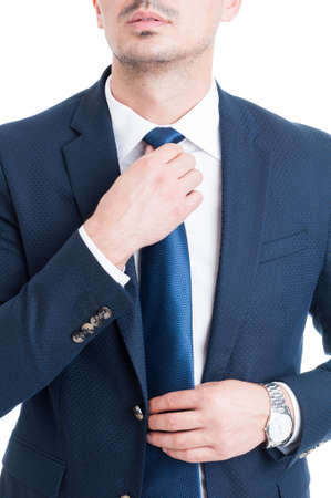 salesman: Salesman or broker fixing and adjusting his blue necktie concept on white background