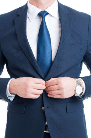 salesman: Fashionable salesman or lawyer closing his elegant blue suit jacket on white background Stock Photo