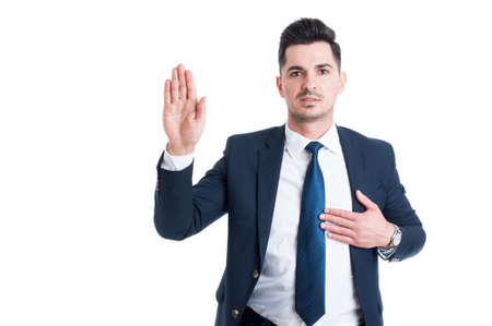 Honest lawyer hand over heart as swear or oath gesture for law and justice concept