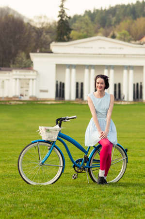 freetime activity: Portrait of happy hipster woman enjoying spring on a bicycle as freetime activity concept