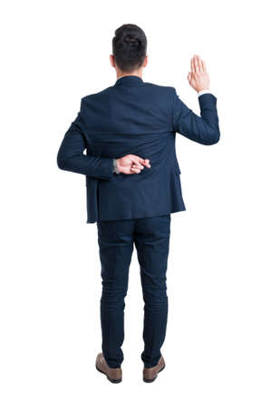 Back view of lawyer making fake oath with fingers crossed standing isolated on white background Фото со стока