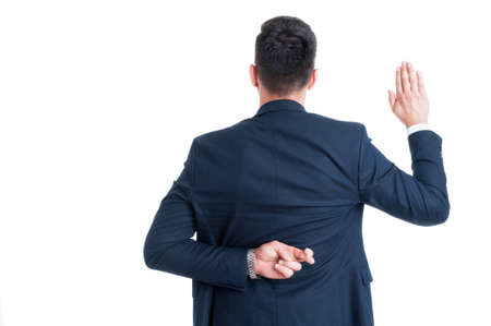 Dishonest lawyer making fake oath or pledge with fingers crossed behind back