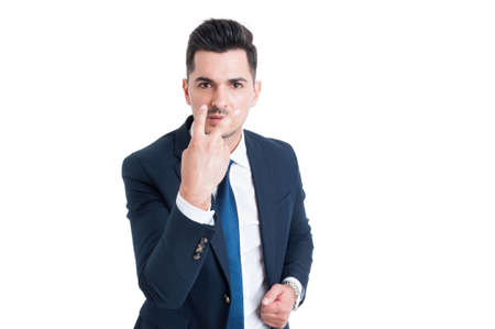 Businessman making look into my eyes and pay attention gesture isolated on white background